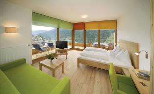 Panoramic luxury room with scenic windows on 2 sides