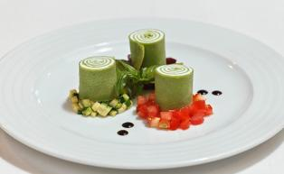 Parsley cr�pe rolls filled with crème fraiche served on a ragout of three kinds of vegetables