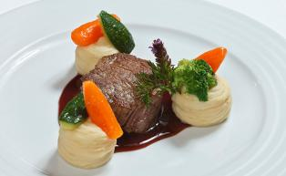 Beef filet with potato puree and vegetables