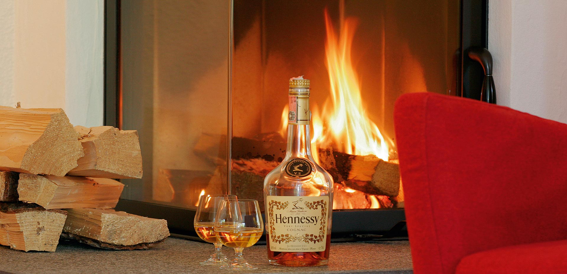Cozy atmosphere next to the fire, with a glass of good Cognac